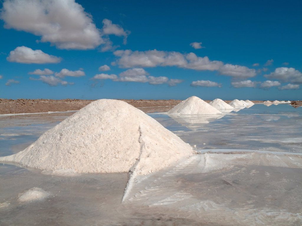 Stock Photo: 1566-884166 Morocco - Salt works at the salt marshes of Sabkhat Tazra in the Khenifiss National Park near the coast of the Atlantic Ocean east of Tarfaya  Southwest Morocco