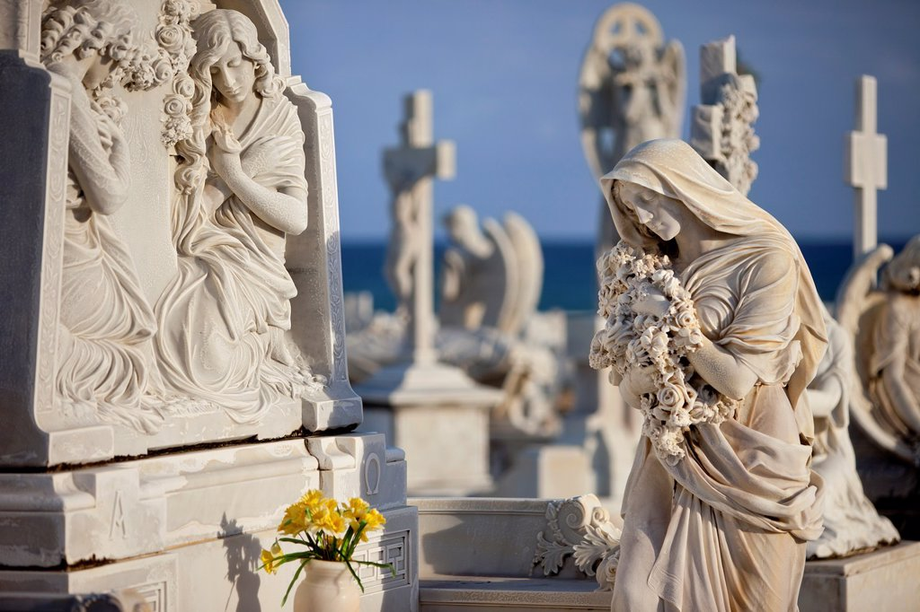 Stock Photo: 1566-884520 Memorial angel statues on gravesite in historic Santa Maria Magdalena de Pazzis Cemetery in old San Juan Puerto Rico