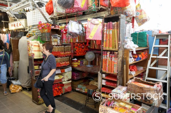 Stock Photo: 1566-885457 woman selling offerings at religious stall at aberdeen municipal indoor market hong kong hksar china asia