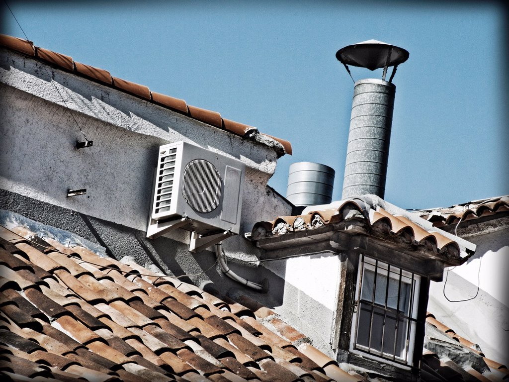 Roof of a house equipped with air conditioning. : Stock Photo