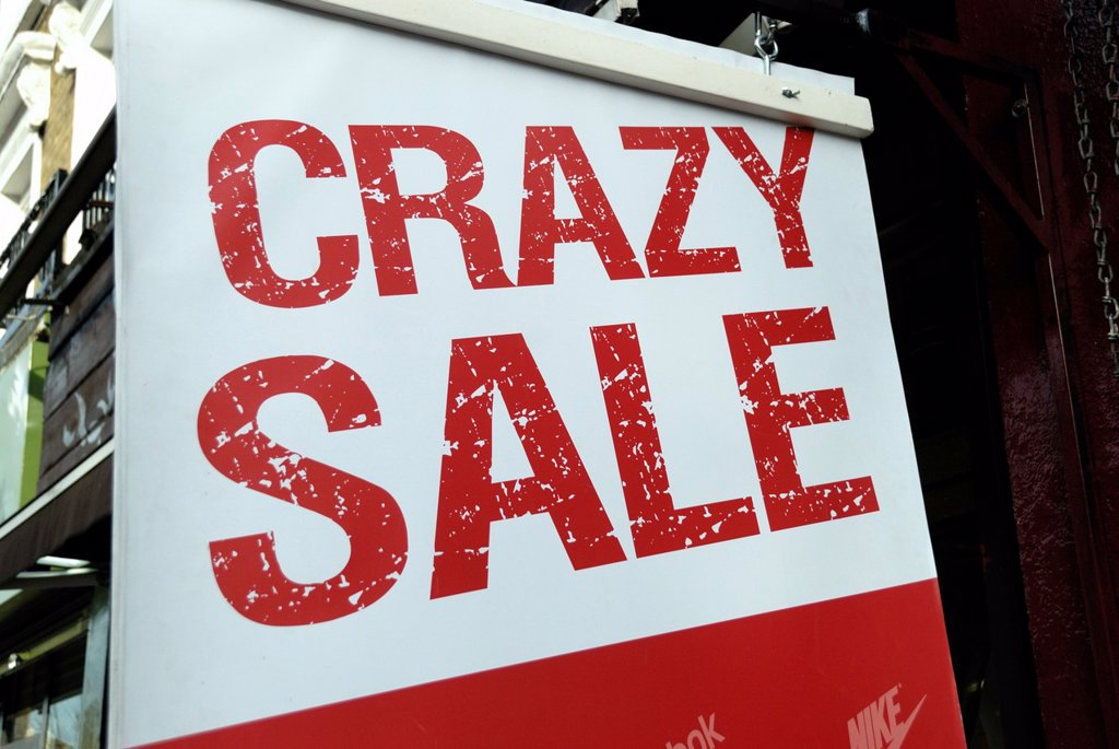 ´ Crazy Sale ´ sign outside a shop : Stock Photo
