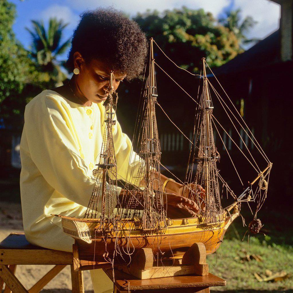 Stock Photo: 1566-887292 Woman making model sailboat, Mahé Island, Seychelles