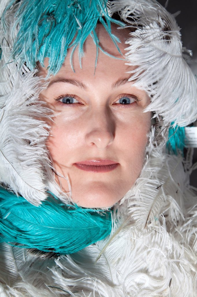 Stock Photo: 1566-887736 Woman surrounded by feathers