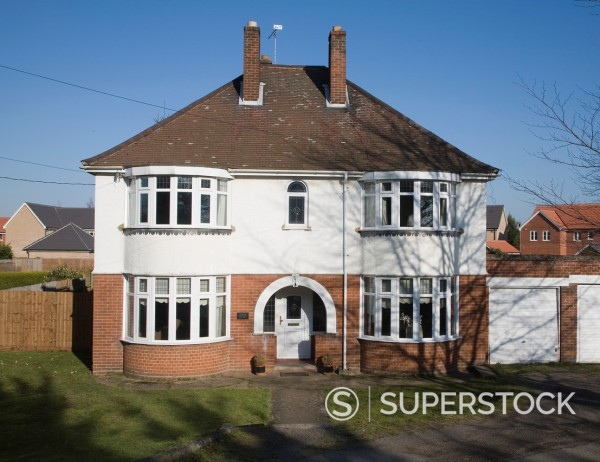 Stock Photo: 1566-888454 Large detached inter-war house with bay windows, Claydon, Suffolk, England