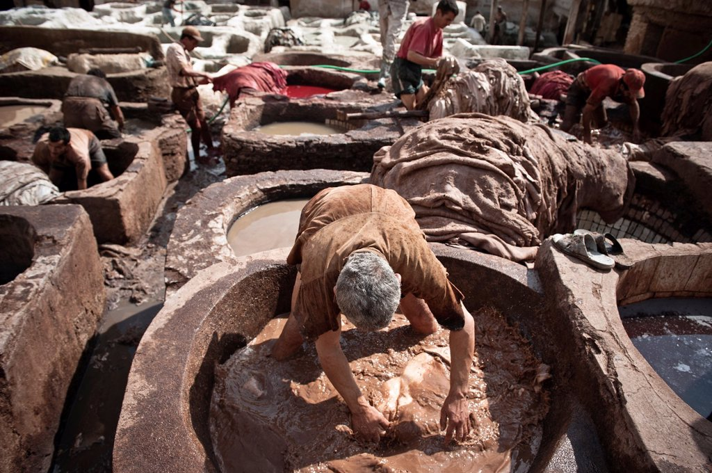 People at work in the Chouwara Leather Tannery of Fez, Morocco : Stock Photo