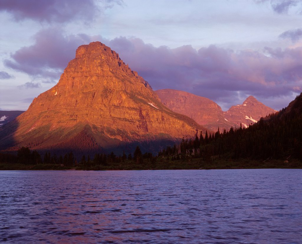 Stock Photo: 1566-889598 Sunrise on Sinopah Mountain above wind tossed water of Pray Lake, Glacier National Park, Montana, USA