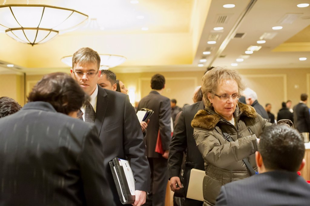 Job seekers attend a job fair in midtown in New York : Stock Photo