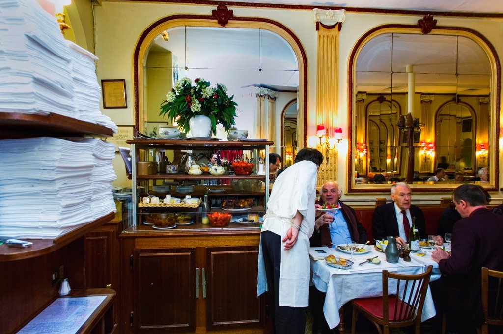 PARIS, France, - Adults Sharing Meals French Bistro Restaurant  Business Lunch at Chez Georges, 1, Rue deu Mail, 75002  Waiter Serving Tables : Stock Photo