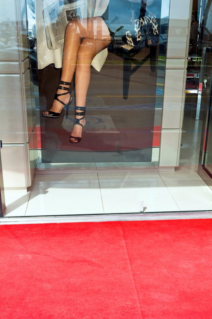 Europe, France, Alpes-Maritimes, Cannes, Film Festival  Young sexy woman, sitting in a café seen through the window : Stock Photo