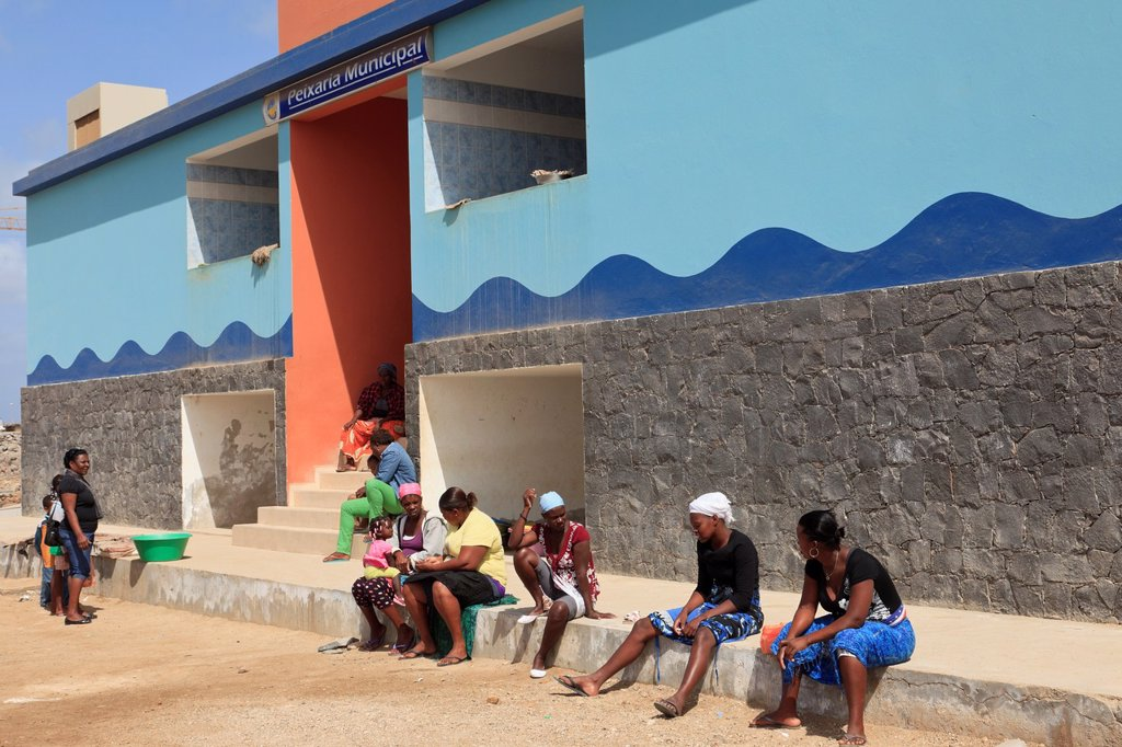 Sal Rei, Boa Vista, Cape Verde Islands, Africa  Port scene with local women sitting outside the municipal fish market : Stock Photo