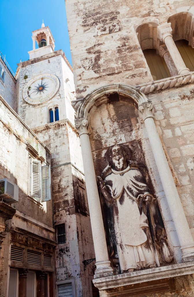 Stock Photo: 1566-891877 A statue of a religious figure carved into the wall of a building at the corner of a street in Split, Croatia