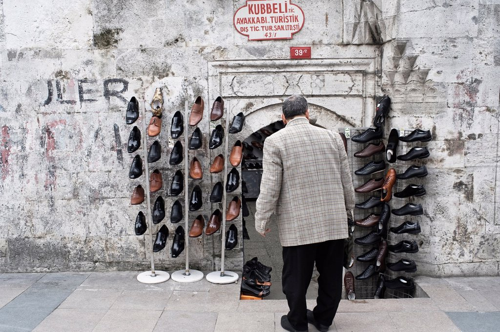 Stock Photo: 1566-892157 Man looking at shoes store in the street of istanbul, Turkey