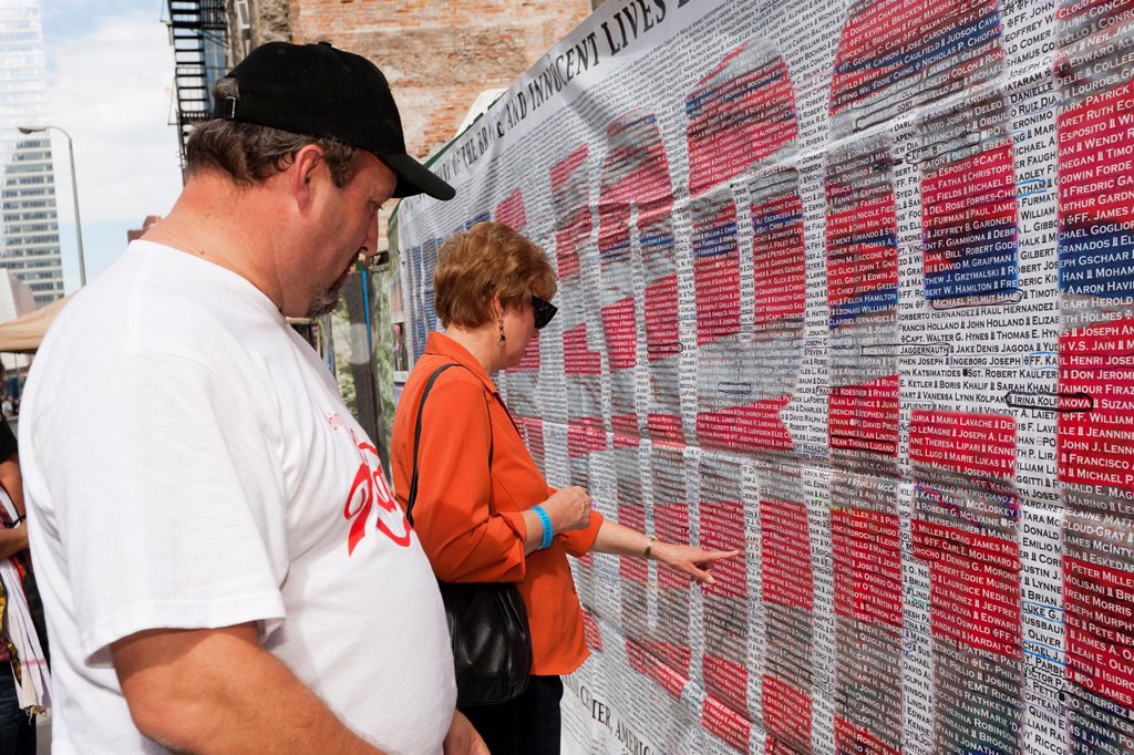 Stock Photo: 1566-892345 Visitors search for names on the list of those who perished in the 9/11 terrorist attack of the World Trade Center. The list is posted on Greenwich Street across from the entrance to the National September 11 Memorial in New York City, New York, USA