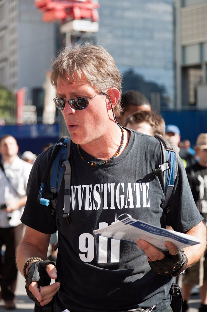 Stock Photo: 1566-892354 A protester wearing an ´Investigate 911´ shirt hands out literature at the World Trade Center PATH station in New York City, New York, USA