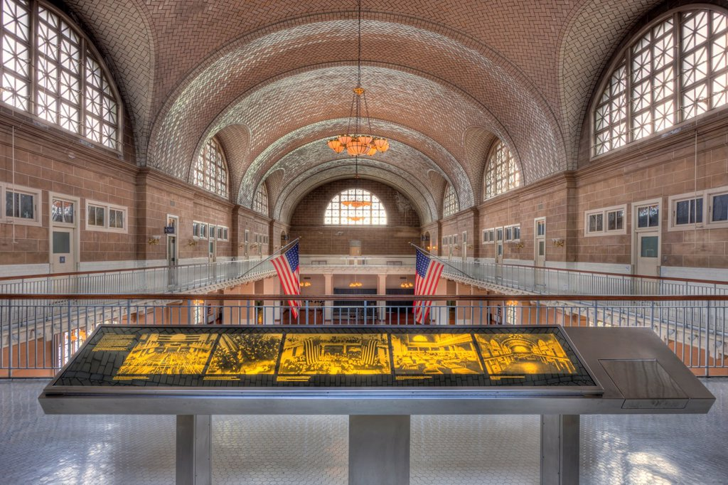 A view of the Ellis Island Registry Room the Great Hall from the 2nd floor balcony inside the Ellis Island Immigration Museum. The Museum is part of the Statue of Liberty National Monument. : Stock Photo