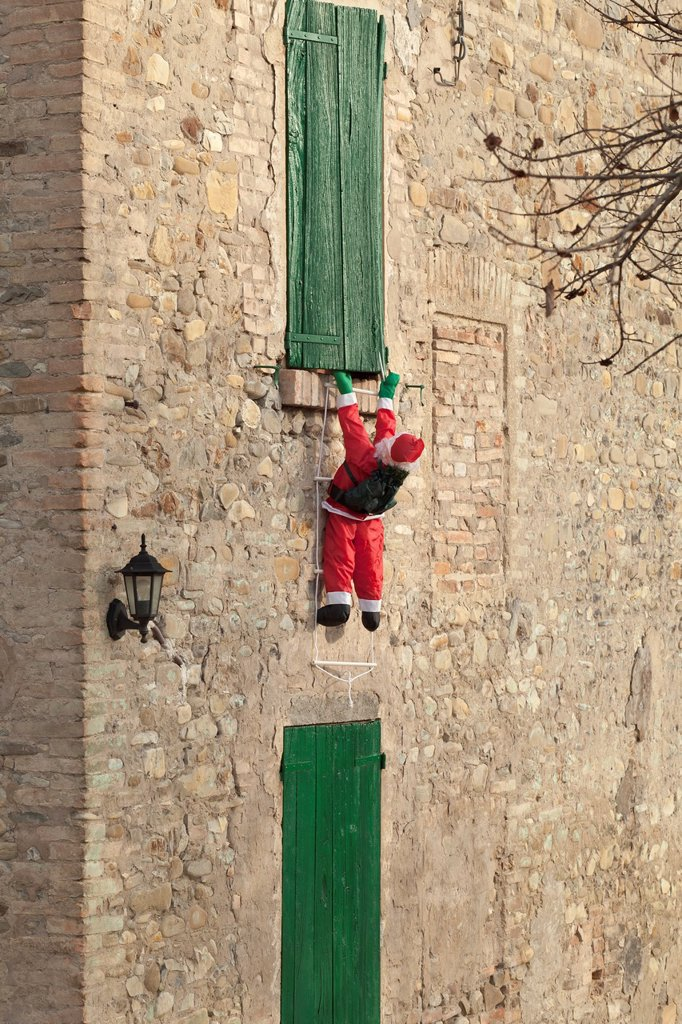Santa claus climbing wall, Italy : Stock Photo