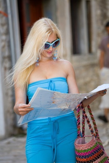 Attractive young woman with a map : Stock Photo