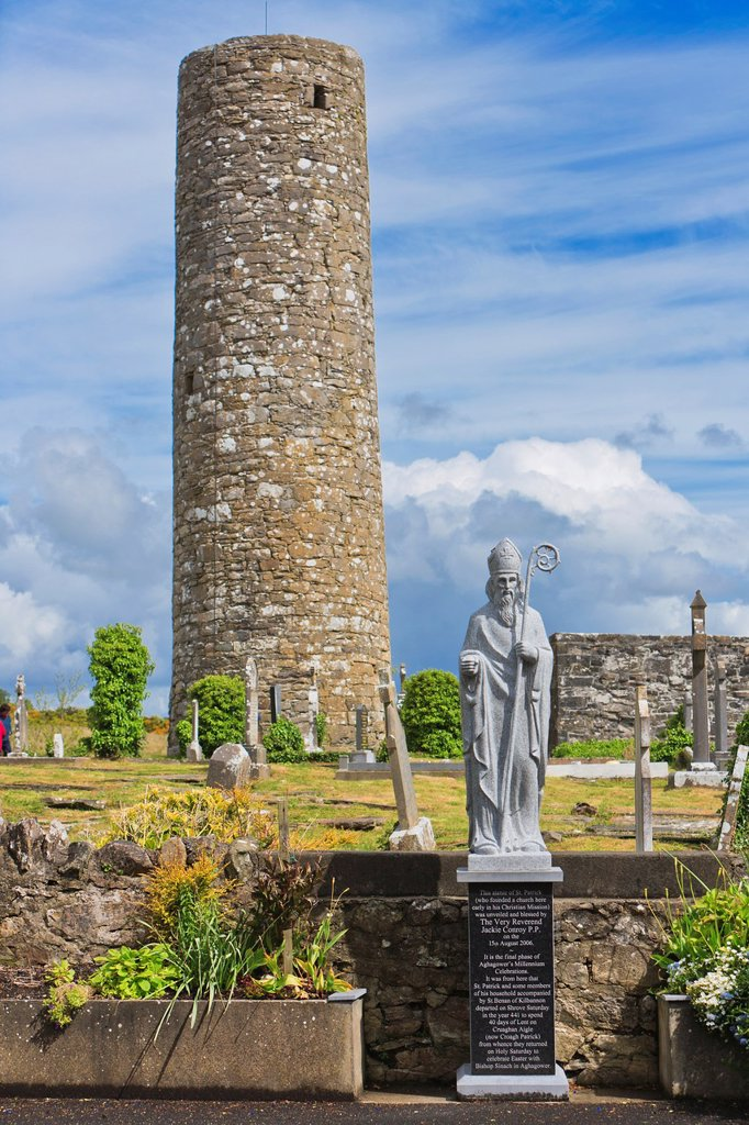 Stock Photo: 1566-893966 Statue of Saint Patrick and Roundtower, Aghagower, County Mayo, Ireland, Europe