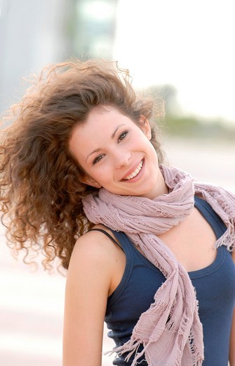 Cute teen moving her long curly hair : Stock Photo
