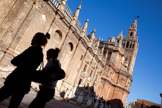 Stock Photo: 1566-900890 Cathedral and Giralda tower from Plaza del Triunfo,Sevilla,Andalucía,Spain