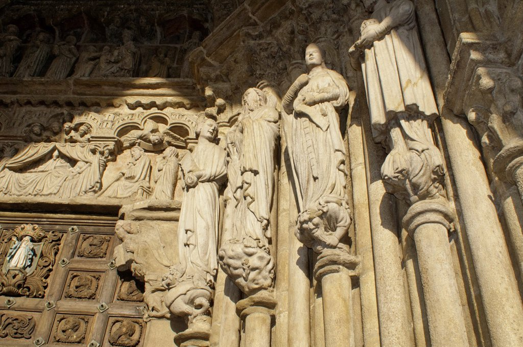 Stock Photo: 1566-904782 The Tui Cathedral artistical door, with ancient characters, Tui, Pontevedra, Galicia, Spain