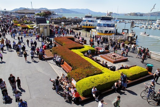 Stock Photo: 1566-904912 California, San Francisco, The Embarcadero, Pier 39, waterside recreation area, Fisherman´s Wharf, water, entrance, busy plaza, shopping, dining, crowded, landscaping, boat,