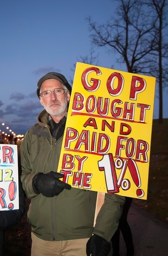 Stock Photo: 1566-904989 Auburn Hills, Michigan - People picket outside the Republican Presidential Debate at Oakland University