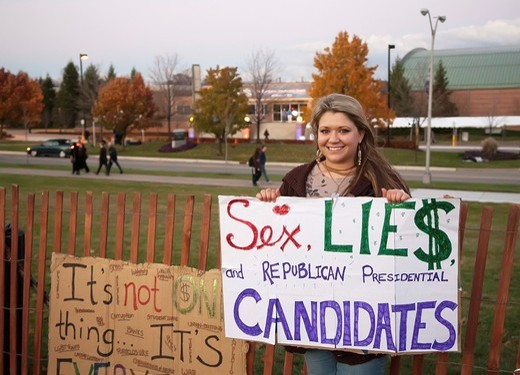 Stock Photo: 1566-904990 Auburn Hills, Michigan - People picket outside the Republican Presidential Debate at Oakland University