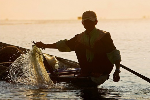 Stock Photo: 1566-905112 Man fishing at dawn on Song Huong Perfume River Hue central Vietnam