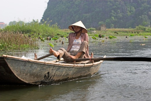 Unusual foot rowing Tam Coc area of Ngo Dong River near Ninh Binh north Vietnam : Stock Photo