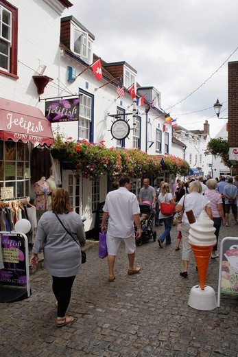 People walking through Quay Street Lymington Hampshire : Stock Photo