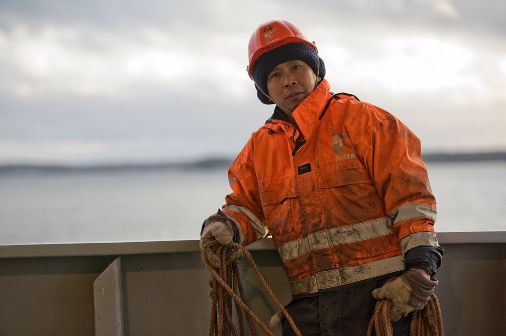 An Indonesian seaman or sailor on the container-vessel MV Flintercape, during a journey from Rotterdam, Netherlands, to Sundsvall, Sweden. The man is an ´Able Seaman´, who generally works on deck. : Stock Photo