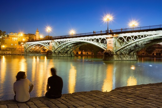 Isabel II bridge or Triana bridge, in Guadalquivir river,Sevilla,Andalucía,Spain : Stock Photo