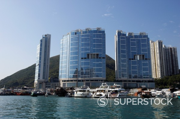 Stock Photo: 1566-906762 shipyards in front of the larvotto towers ap lei chau aberdeen harbour hong kong hksar china asia the towers have gaps in the design to allow the flow of the mountain spirits through down to the sea
