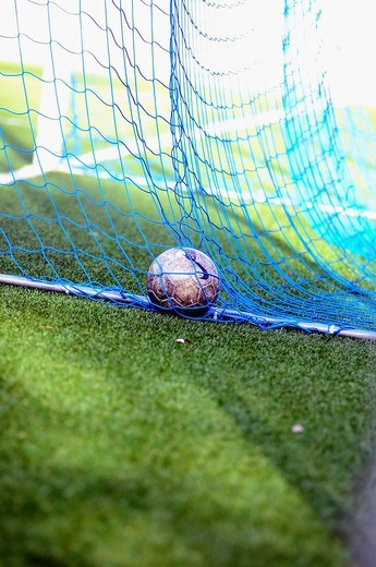 Stock Photo: 1566-906985 Soccer ball into a goal in soccer 11