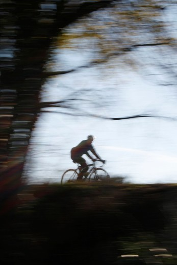 person riding fast bike in countryside in rome italy : Stock Photo