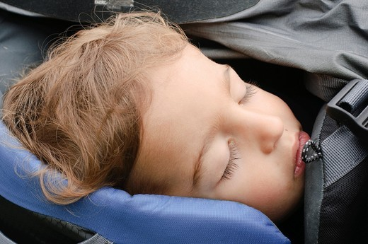 Boy of two asleep in a backpack baby carrier  Photogrpahed in the Austrian Alps : Stock Photo