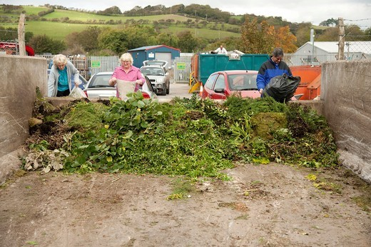 Stock Photo: 1566-909542 People dumping sacks of green garden waste at a recycling centre UK