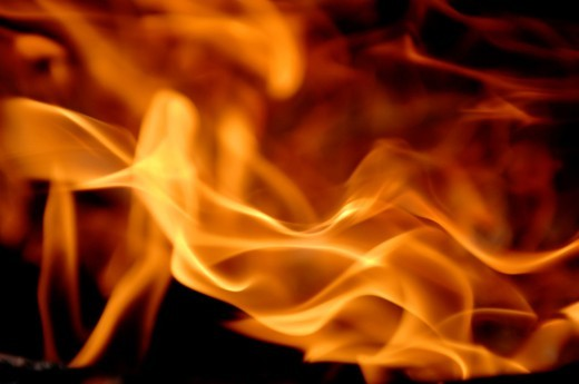 Abstract flames against black background : Stock Photo