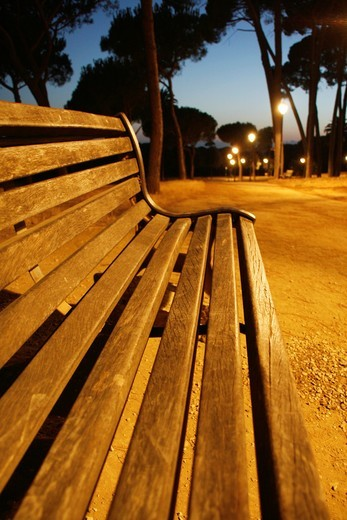 Stock Photo: 1566-910697 empty bench in villa pamphili park in rome at night