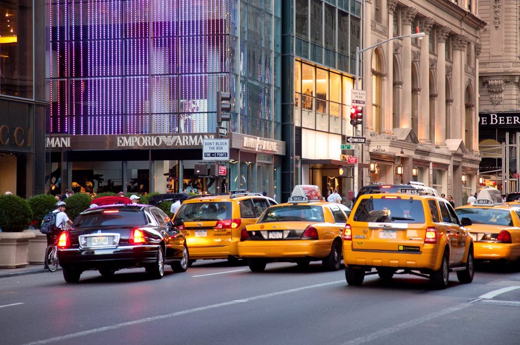 Stock Photo: 1566-911067 Taxis waiting for traffic signal along 5th Avenue in Manhattan, New York City, USA