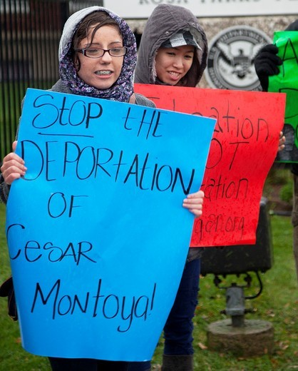 Stock Photo: 1566-912022 Detroit, Michigan - People picket the Immigration and Customs Enforcement office in a heavy rain storm to protest the pending deportation of Cesar Montoya  He was brought to the U S  ten years ago at age 14, and would be eligible to stay under the DREAM A. Detroit, Michigan - People picket the Immigration and Customs Enforcement office in a heavy rain storm to protest the pending deportation of Cesar Montoya  He was brought to the U S  ten years ago at age 14, and would be eligible to stay under