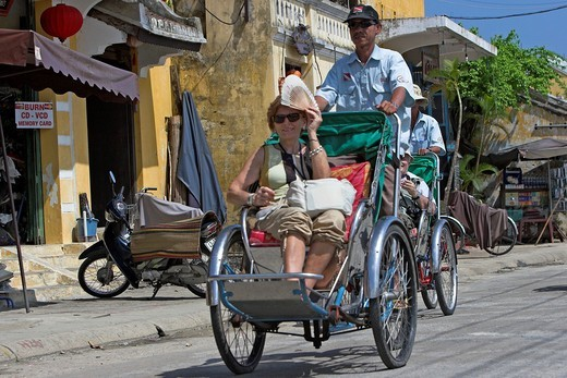 Stock Photo: 1566-912180 Visitor on cyclo rickshaw tour of Hoi An historic town riverside mid Vietnam