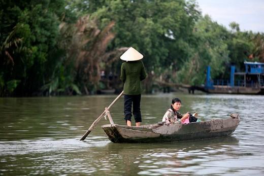 Stock Photo: 1566-914414 Women rowing. Mekong River, Mekong Delta, My Duc. Vietnam