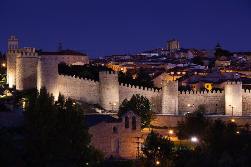Spain, Castilla y Leon Region, Avila Province, Avila, Las Murallas, town walls from Los Cuarto Postes, dusk : Stock Photo