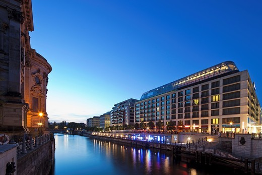 Stock Photo: 1566-915197 Twilight view of the Radisson Blu Hotel with the back end of the BerlinerDom on the left  Mitte, Berlin, Germany