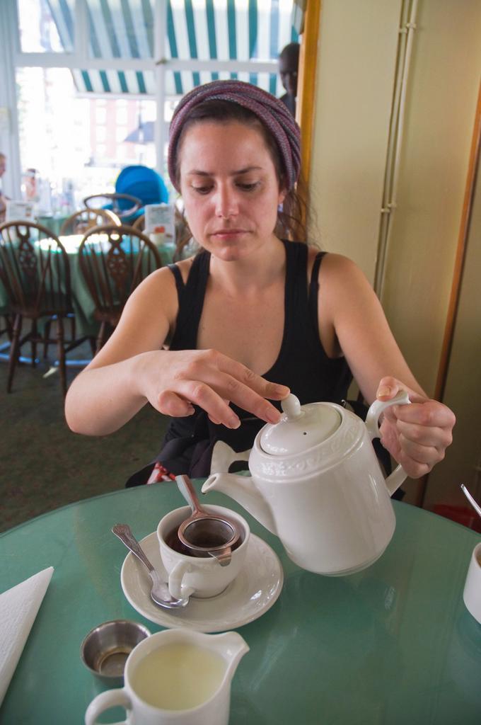 Tea drinking Muffinman tea room Kensington district London England UK Europe : Stock Photo