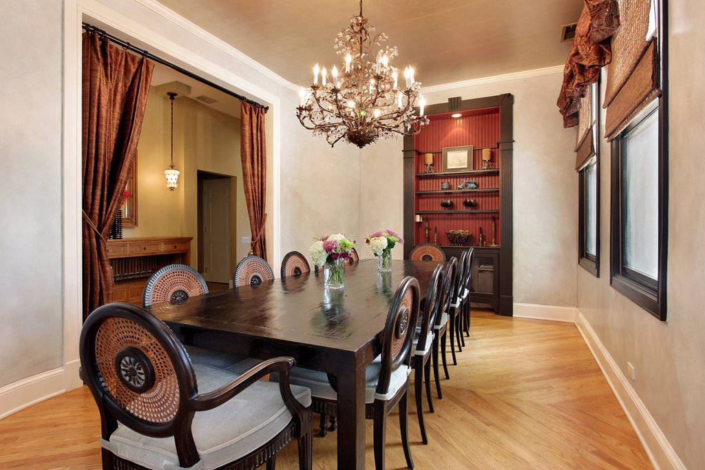 Stock Photo: 1566-917810 Dining room in luxury home with built in cabinet