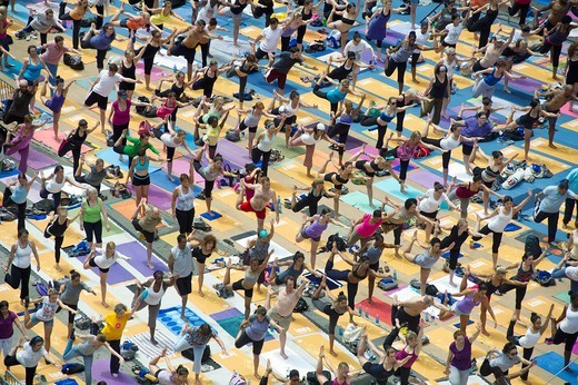 Thousands of yoga practitioners in Times Square in New York participate in a group Bikram Yoga class observing the Summer Solstice  The classes given throughout the day attract thousands of students of various levels who practiced their art and attempted. Thousands of yoga practitioners in Times Square in New York participate in a group Bikram Yoga class observing the Summer Solstice  The classes given throughout the day attract thousands of students of various levels who practiced their art and : Stock Photo