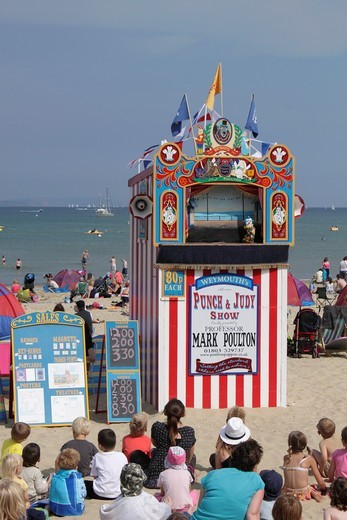 Punch and Judy show Weymouth beach Dorset : Stock Photo